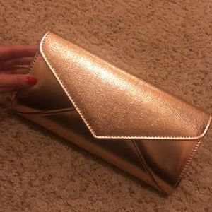 NWOT rose gold clutch
